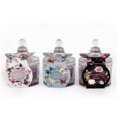 An assortment of 3 beautifully scented candles set within ribbed jars. Complete with attractive antique floral packaging