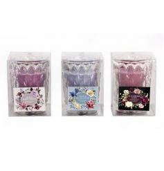 An assortment of beautifully scented coloured candles set within antique style cut glass jars.