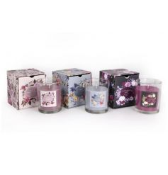 An assortment of 3 scented candles in attractive floral packaging.