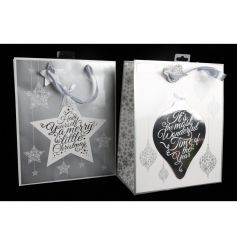 A mix of 2 white and silver festive gift bags with Christmas slogans.