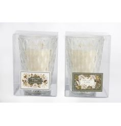 An assortment of 2 festive candle pots set within decorative glass pots.