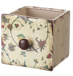 A charming ceramic planter in the style of a drawer complete with a bird and floral illustration.