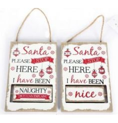 A nordic style red and white spinning sign. A novel home decoration to decide whether you've been naughty or nice!