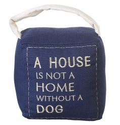 A practical doorstop with an embroidered slogan reading 'A house is not a home without a dog'.