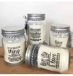 An assortment of 4 candles in glass jars with mottos