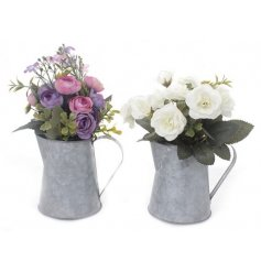 A mix of 2 beautiful floral displays set within zinc jugs. A ready made chic accessory for the home.