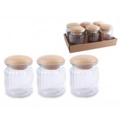 A stylish case of ribbed glass jars, complete with a natural toned wooden lid
