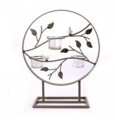 Create a statement with this ornate triple t-light holder with a decorative leaf design, complete with ceramic birds.