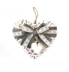 A shabby chic style white wicker heart decoration with a grey and lace ribbon bow.