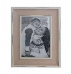A beautifully shabby chic themed wooden picture frame, finished with a homely white wash