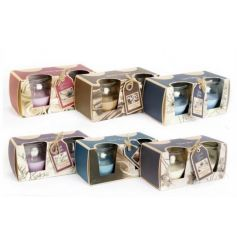 An assortment of colourful scented candles sold in twin packs. A great gift item and home accessory.