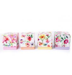 A mix of 4 bright and beautiful floral designed candle pots with scented candles. A lovely gift item.