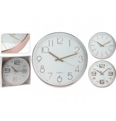 A mix of 3 rose gold contemporary design clocks. A chic decoration for the home and gift item.
