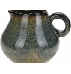 An artisan ceramic jug with a blue and brown glazed finish. A chic decorative jug with many uses.
