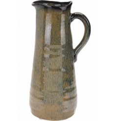 A tall artisan ceramic jug with a blue and brown glazed finish. A chic decorative jug with many uses.