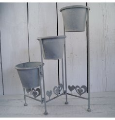 Bring a distressed vintage charm to any home or garden with this stylish planter