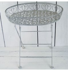 A beautifully distressed finished metal garden table