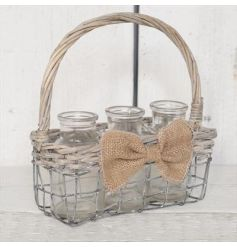 sweetly placed inside a woven willow and metal basket