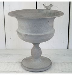 this stylishly distressed finished planter will add a vintage feel to any garden,