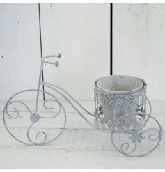 A vintage grey metal tricycle styled planter, perfect for any garden decor