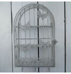 This stylish vintage shelving unit is perfect for displaying artificial flowers or vintage products.