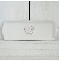 This dainty floral heart pattered ceramic tray will add a touch of vintage charm to any kitchen