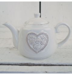 This dainty floral heart pattered teapot will add a touch of vintage charm to any kitchen