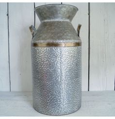 This antique styled zinc churn will display gracefully in any rustic themed environment,