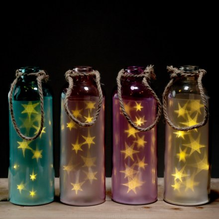 Multi Toned LED Bottles  A quirky assortment of coloured glass bottles, fitted with warm glowing LED stars