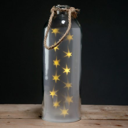 A quirky frosted glass jar with fitted led lights, stylishly shaped into stars