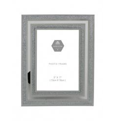 Add some sparkle to the home with this stylish mirror and silver glitter photo frame.