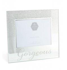 A glamorous silver glitter photo frame with a glitter Gorgeous slogan.
