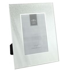 A silver glitter ombre style glass photo frame. A timeless decorative accessory with a touch of glamour.
