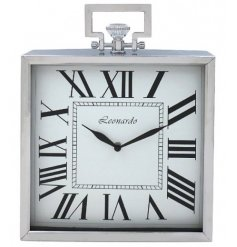 A fine quality silver square clock with handle.