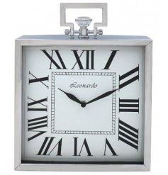 A stylish silver square clock with roman numerals.