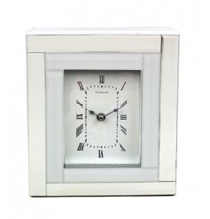 A stunning, fine quality mirror and polished white glass clock with elegant roman numerals.