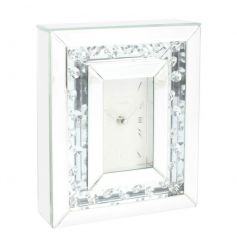Add some glamour to the home with this fine quality glass clock with floating crystals.