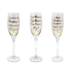 An assortment of 3 Prosecco flutes each with a different gold slogan with bubbles.