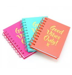 A mix of 3 pink, coral and blue colourful notebooks with Good Vibes Only slogans.