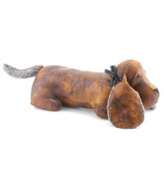 A rustic style faux leather dachshund doorstop with faux fur ears and tails. Complete with a chic bow.