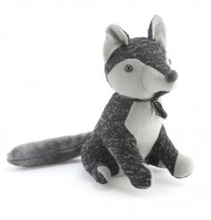 An adorable fox doorstop in two-tone grey fabric with a chic bow to finish.