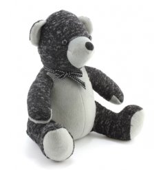 This charming teddy bear doorstop makes a chic addition to any home. Complete with a fabric bow.