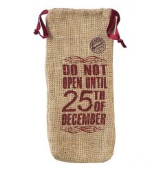 A drawstring hessian christmas wine gift bag