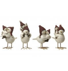 An assortment of 4 mother and baby bird christmas ornaments