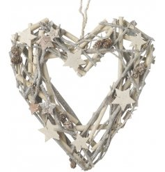 A white and silver twig wreath in the shape of a heart