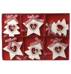 A box of 6 Wooden Hearts & Stars With Bells Hanging Decorations