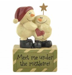 A cute resin based snowman figure with 'Meet me under the mistletoe' quote engraved in