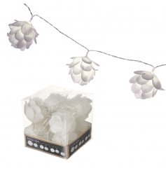 A glittery white flower garland with LED battery lights