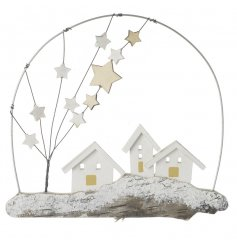 A wooden christmas scene hanging decoration with stars