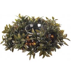 A traditional small wreath tealight holder Christmas table decoration